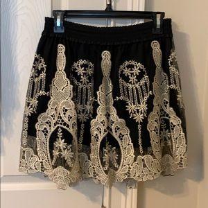 Anthropologie black mini skirt with slip